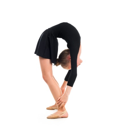 limber: little gymnast in black costume doing an exercise isolated on white background