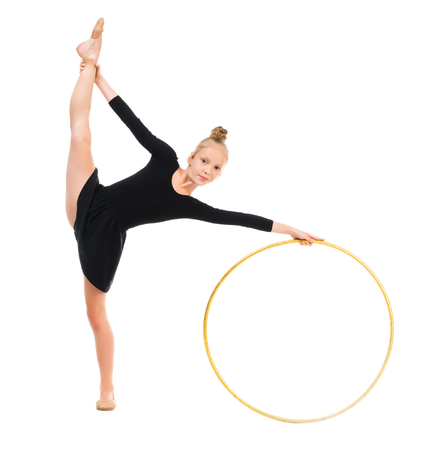 limber: little gymnast doing exercise with hoop isolated on white background