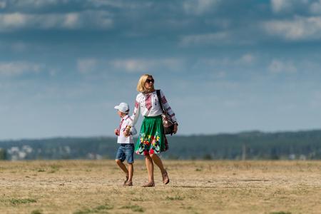 aerodrome: UKRAINE, KHARKIV -AUGUST 24: mother and son on aerodrome at Kharkiv on Ukraine Independence Day     in Kharkiv on August 24, 2015 Editorial