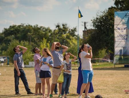 aerodrome: UKRAINE, KHARKIV -AUGUST 24: people watching airshow on Kharkiv aerodrome on Ukraine Independence Day  in Kharkiv on August 24, 2015