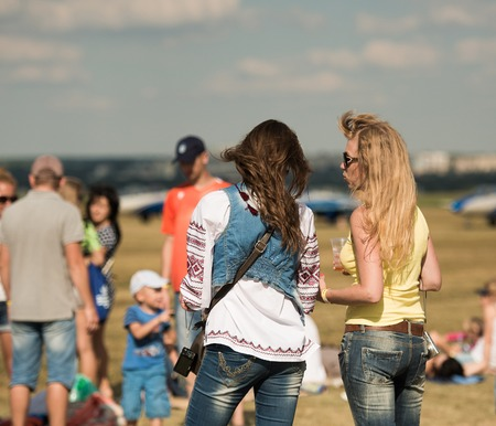 airshow: UKRAINE, KHARKIV -AUGUST 24: people watching airshow on Kharkiv aerodrome on Ukraine Independence Day  in Kharkiv on August 24, 2015