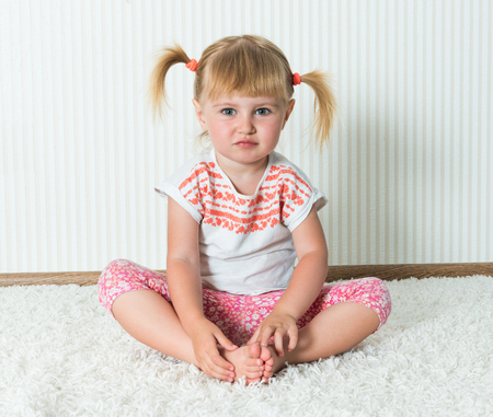 2 year old: 2-year-old girl engaged in physical activity at home
