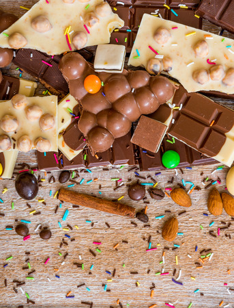 chocolate candy: chocolate and candies on a wooden background
