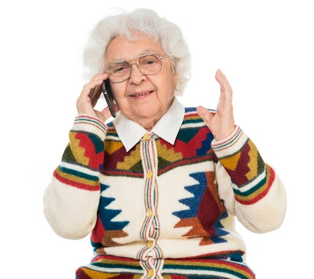 excited woman: elderly woman talking on the mobile phone isolated on white background