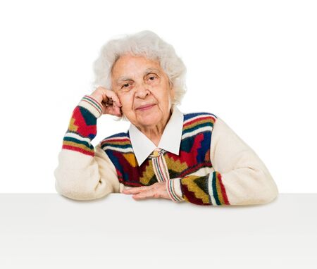 the great grandmother: elderly woman behind an advertising board over white background Stock Photo