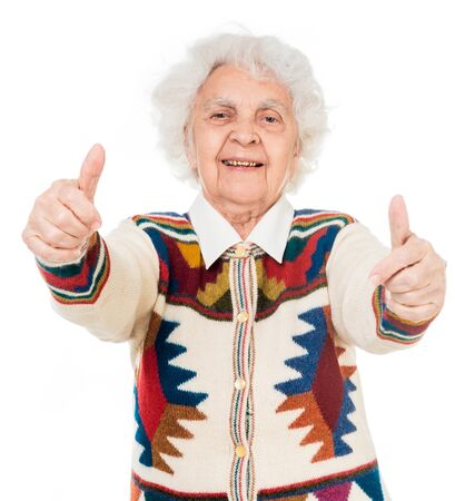 great grandmother: elderly woman with thumbs up isolated on white background Stock Photo