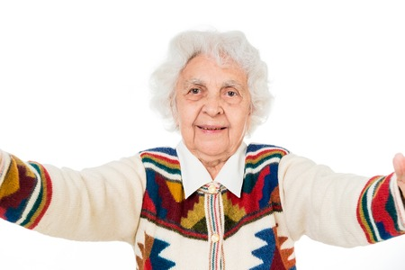the great grandmother: elderly woman taking selfie on a smartphone isolated on white background Stock Photo