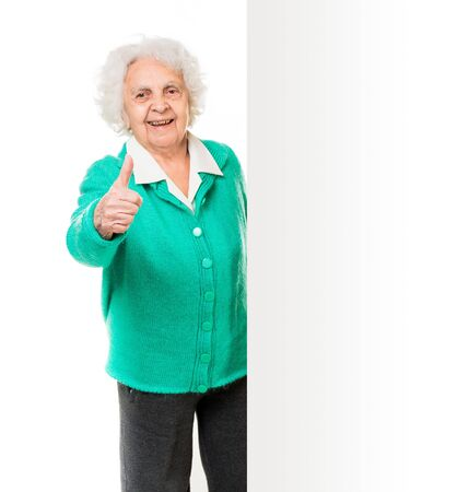 the great grandmother: elderly woman alongside of ad board over white background