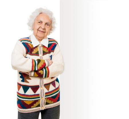 over white: elderly woman alongside of ad board over white background