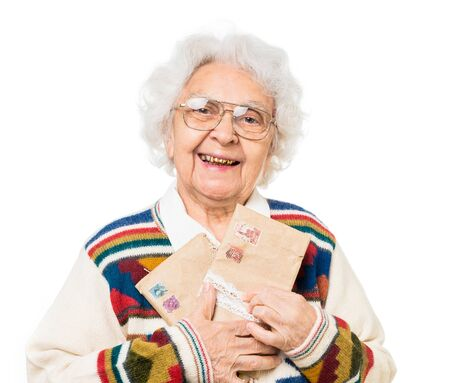 envelops: elderly woman holding old envelops isolated on white background Stock Photo