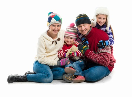 family isolated: happy family portrait in warm clothes isolated on white background