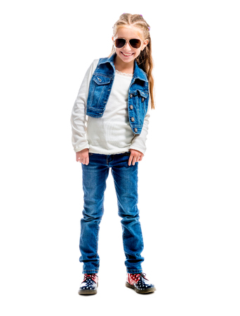 girl boots: little girl with thumb up isolated on white background