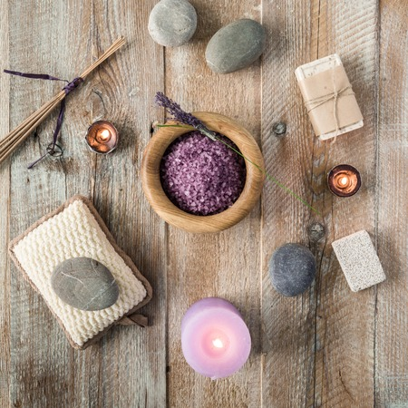candles: Composition of spa treatment items on the wooden table. Top view