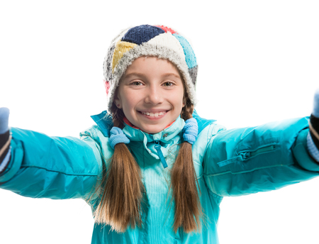 warm clothes: little girl in warm clothes isolated on white background