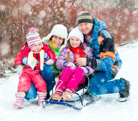 4 people: Winter portrait of happy young family of 4 people