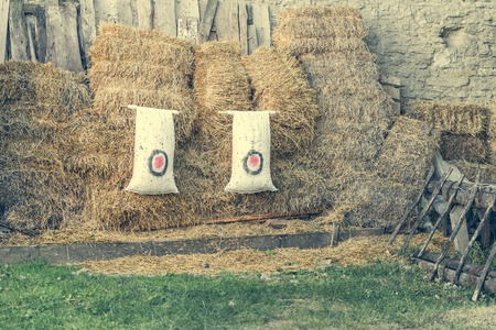 haystacks: archery target on the background of haystacks at countryside