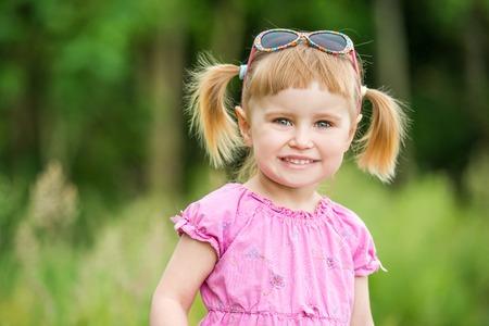 cute little girl: Cute little girl on the meadow in summer day