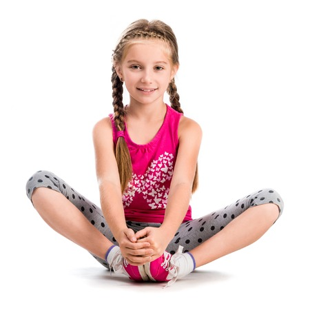 kids activities: little girl doing yoga isolated on white background Stock Photo