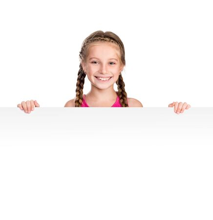 holding blank sign: little smiling girl with white blank close up isolated on white background