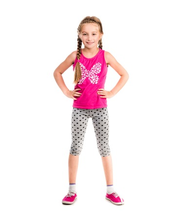 teen girls feet: little girl standing with hands on sides doing fitness