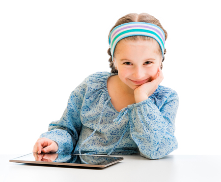 elementary school: Happy little girl and her magic tablet Stock Photo