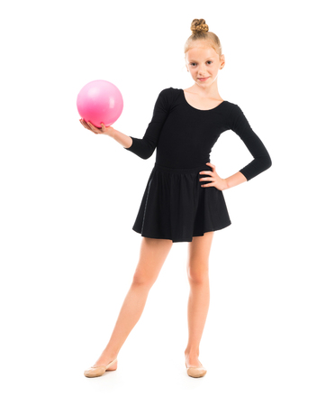 ballerina costume: little gymnast doing exercise with ball isolated on white background