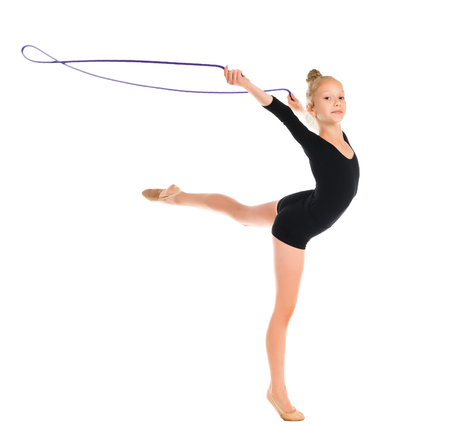 gymnastics: little gymnast doing exercise with skipping rope isolated on white background