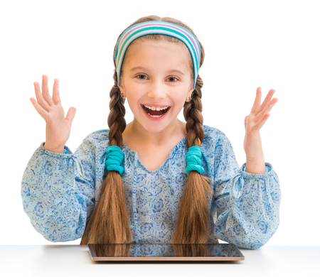 child portrait: Happy little girl and her magic tablet Stock Photo