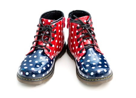 clown shoes: funny patent-leather boots with polka dots Stock Photo
