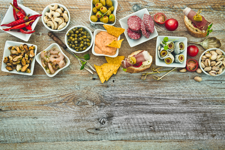 spanish tapas: National Spanish tapas on a wooden background Stock Photo