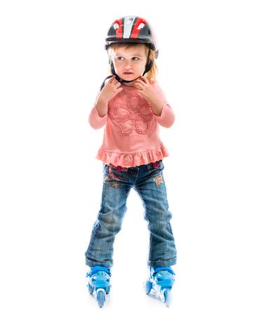 rollerskater: little preschool girl on rollerskates isolated on white background
