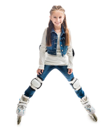 rollerskates: smiling teenager girl on rollerskates isolated on white background Stock Photo