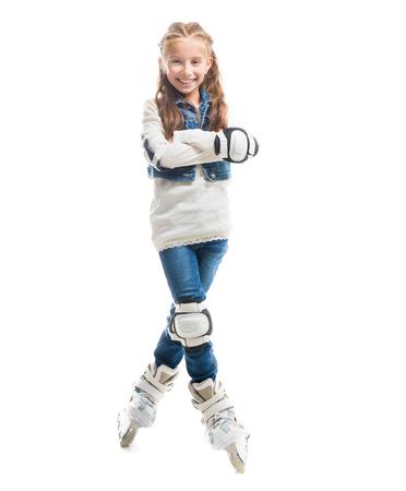 rollerskater: smiling teenager girl on rollerskates isolated on white background Stock Photo