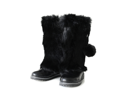 rubber sole: black winter boots with fur isolated on white background Stock Photo