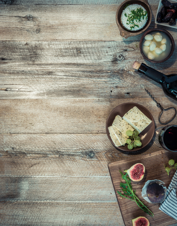 text space: cheeses and brown bread on wooden table with text space