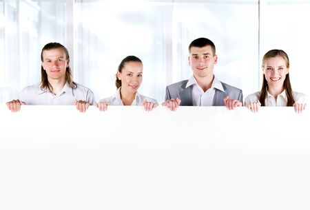 white person: Business team holding a large blank sign on white background