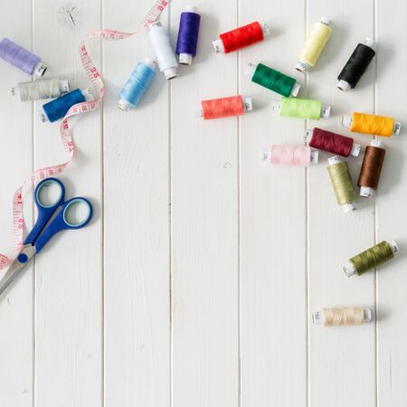 ?text space?: white wooden planks background with colorful thread skeins with text space