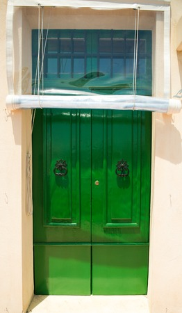 front house: colourful green front door to house