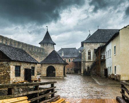 fastness: inside yard  of Khotyn Fortress under rain