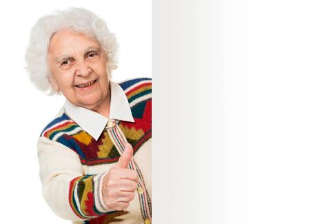 alongside: elderly woman alongside of ad board over white background