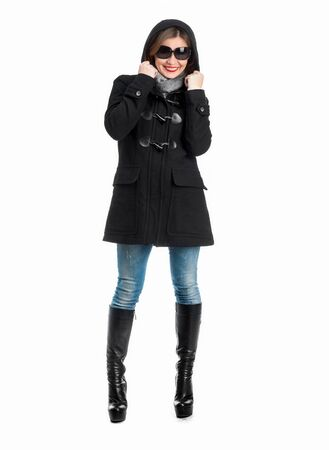 pretty girl in black coat with arms folded isolated on white background photo