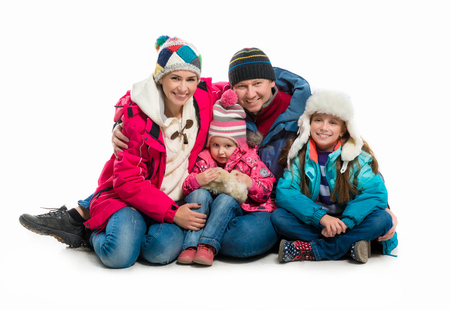 white coat: family in warm clothes alltogether isolated on white background