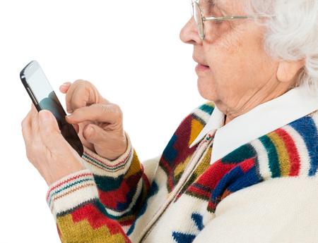 great grandmother: elderly woman using smartphone close-up Stock Photo