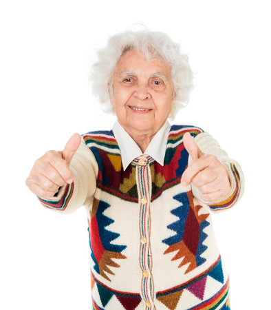 the great grandmother: elderly woman with thumbs up isolated on white background Stock Photo