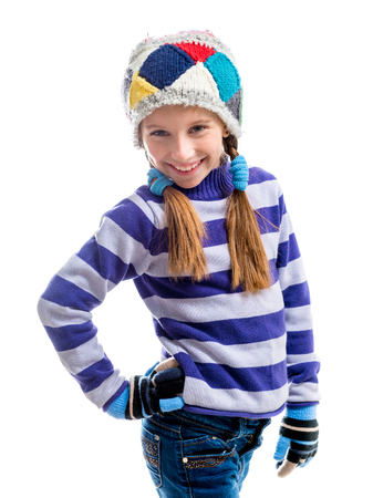 girl boots: little girl in a warm sweater and a cap isolated on white background
