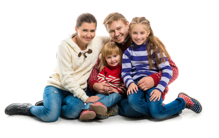 happy family portrait in warm clothes isolated on white background photo