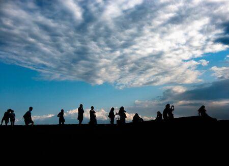 admiring: silhouettes of people admiring sunrise in scenic place in Ukraine