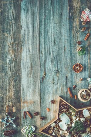 text space: christmas decorations in star shaped box on old wooden background with text space top view