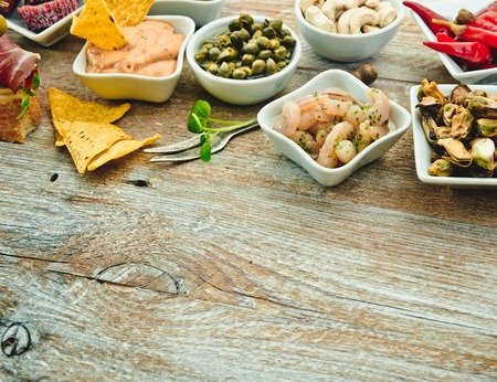 spanish tapas: National Spanish tapas on a wooden background Stock Photo