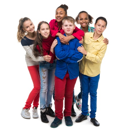group of friends in colorful clothes standing and embracing isolated on white background